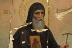 Икона святителя Василия Рязанского, изрубленная топором и обожженная.