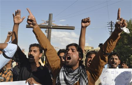 Christian men shout anti-government slogans in Quetta as they protest against a twin suicide bomb attack on a church in Peshawar