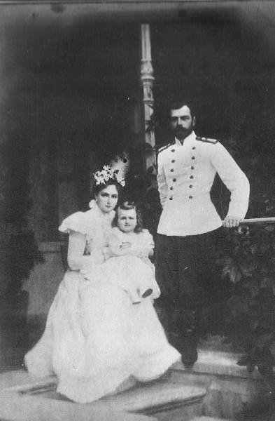 Empress Alexandra with daughter Grand Duchess Olga and Tsar Nicholas II