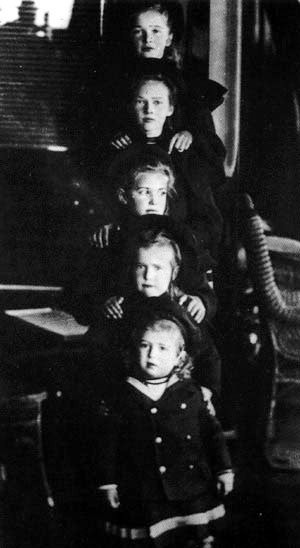 The Grand Duchesses Olga Tatiana Marie and Anastasia with their baby brother the Tsarevich Alexei aboard the imperial yacht The Standart.