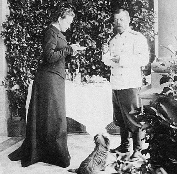 Ella and Nicky at tea, with a cute little yorkie, 1902.