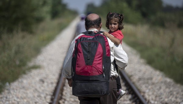 мигранты. рейтерс