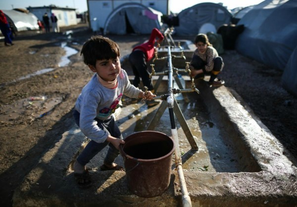 © Leanne Burden Seidel/www.bostonglobe.com Сирийские дети-беженцы из города Кобани в лагере, в городе Суруч, Турция.