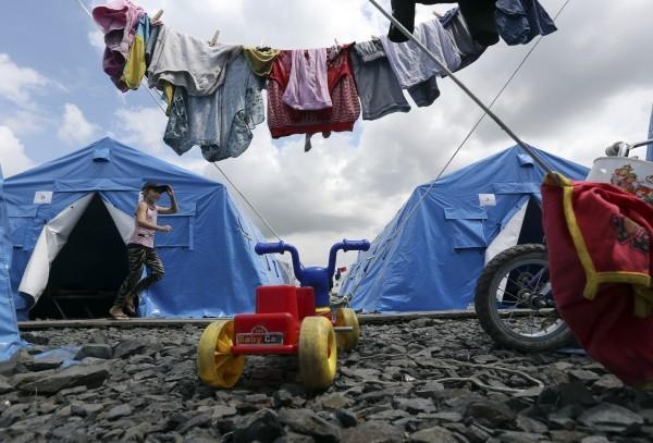 ©REUTERS Sergei Karpukhin Девочка в палаточом лагере для украинских беженцев в городе Новошахтинске Ростовской области.