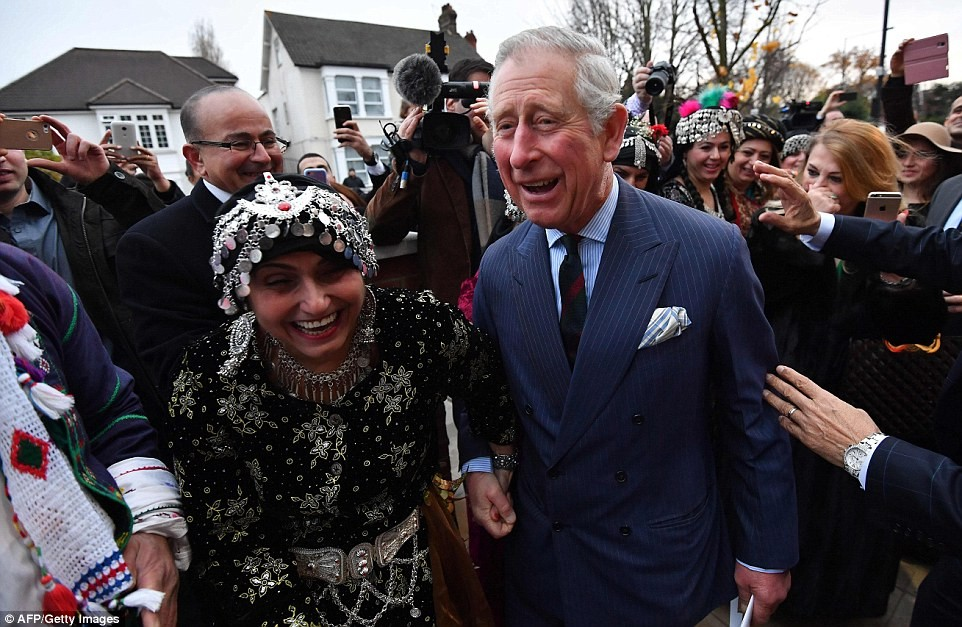 3ab93ffc00000578-3968966-the_prince_of_wales_right_smiles_as_he_holds_hands_with_members_-a-68_1480008703197