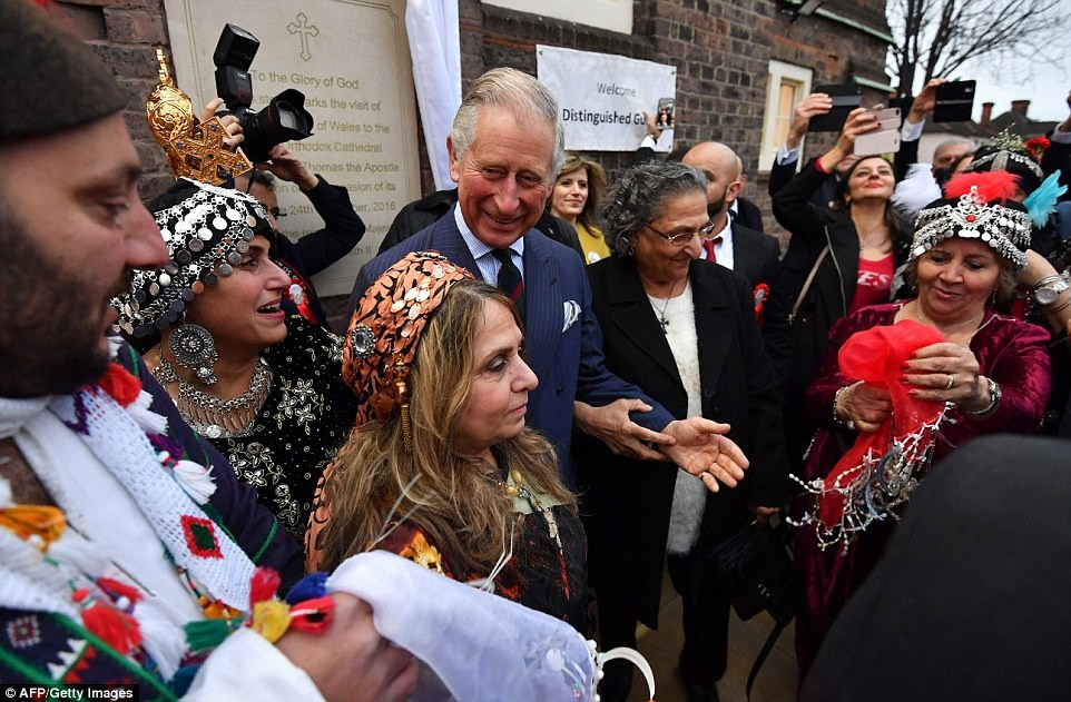 3ab9529000000578-3968966-braving_the_cold_charles_takes_part_in_the_traditional_celebrati-a-66_1480008703139