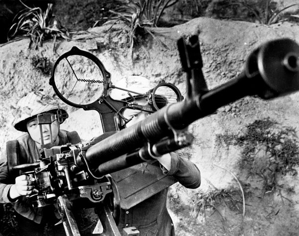 Women of the North Vietnamese Army aiming an anti-aircraft gun in a propaganda photograph during the Vietnam War. (Photo by Central Press/Getty Images)